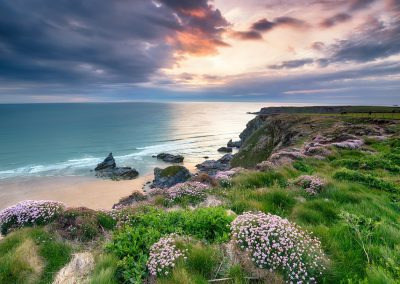 sunset at bedruthan steps in cornwall